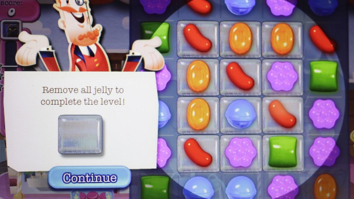 En enkel tre-på-rad-mekanikk og mikrotransaksjoner har gjort «Candy Crush Saga» til en av vår tids største og mest innbringende spillsuksesser. (Foto: AP Photo/Mark Lennihan)