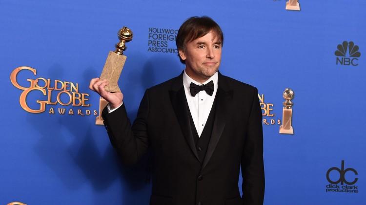 Regissør Richard Linklater med prisen for beste dramafilm for 'Boyhood'. (Foto: Jordan Strauss/Invision/AP, NTB Scanpix).