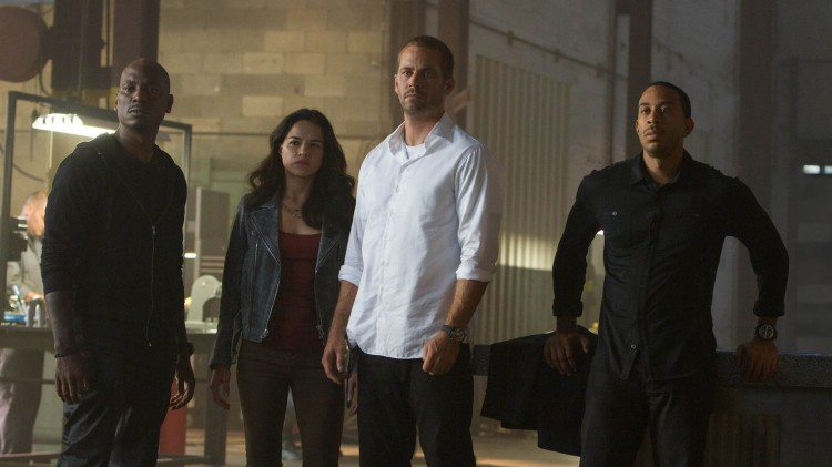 Tyrese Gibson, Michelle Rodriguez, Paul Walker og Ludacris i Fast And Furious 7 (Foto: United International Pictures).