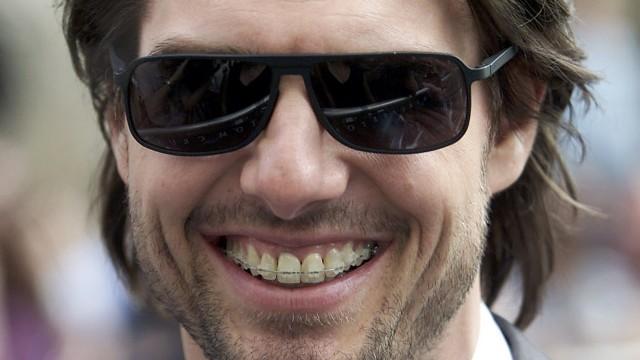 """Tom """"braceface"""" Cruise. Denne gangen uten strikker på reguleringa. (Foto: Reuters/ Michael Crabtree)"""