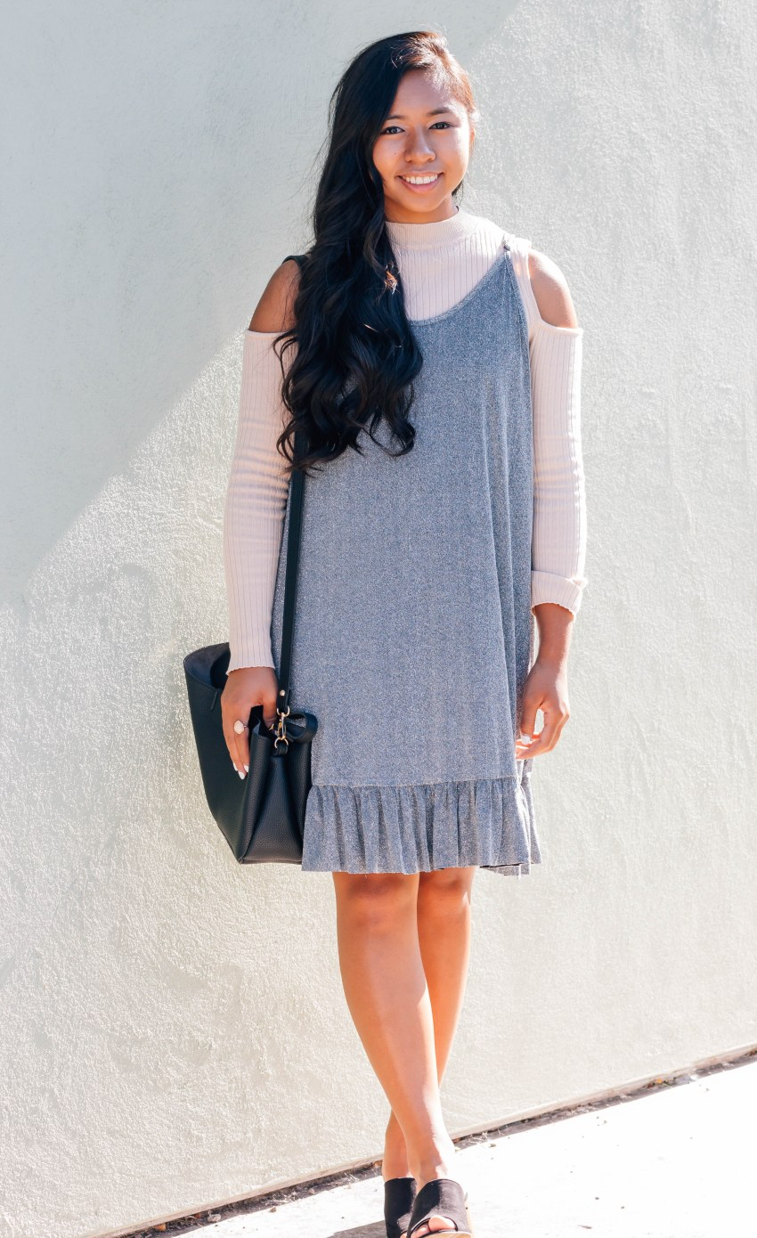 Glitter cami dress over sweater is the perfect going out look for fall.