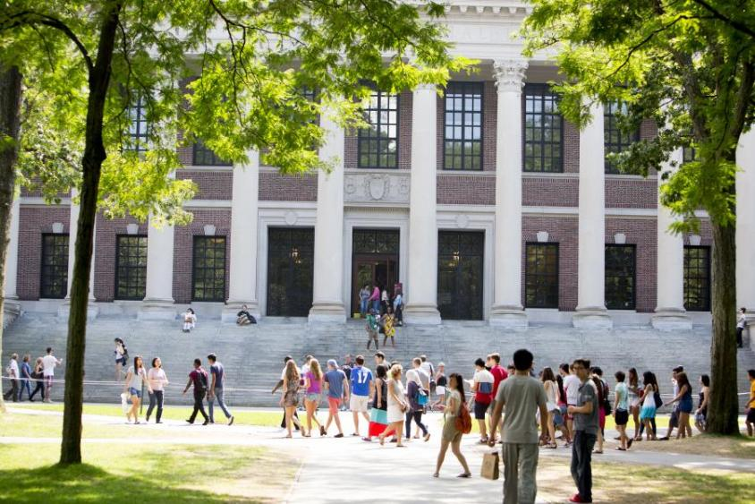 Harvard Campus with students strolling by entrance