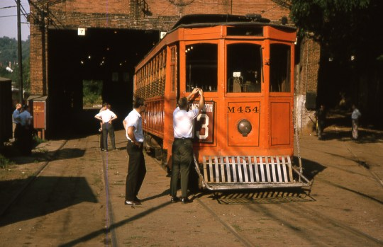 Sister snow scraper M454 being prepared for a fantrip excursion in 1965, at Tunnel Car House.