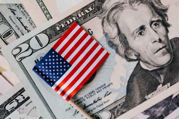 set of usa dollars and national flag