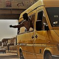 conductor in a yellow trotro