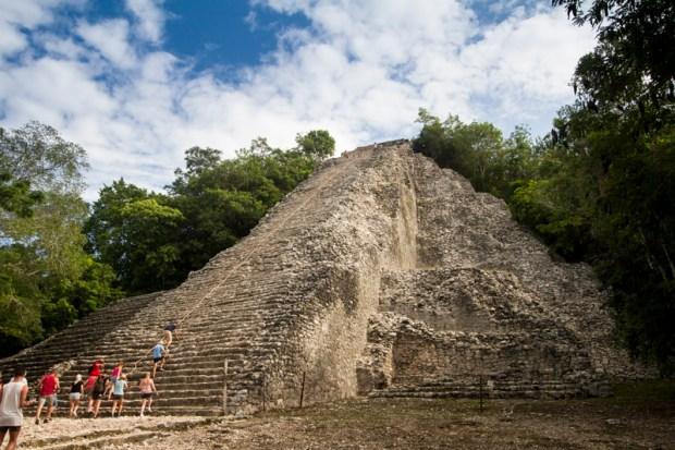 Visitors about to climb a pyramid at Coba
