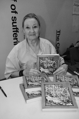 Lolo Houbein signs copies of her book, One Magic Square, at Plains To Plate. Lolo's book metricises the 'square foot gardening' model and applies it to Australian conditions.