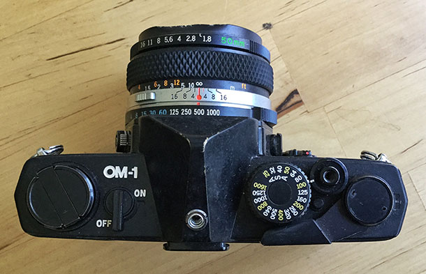 Light weight, low bulk — the Olympus OM1 became available around 1973 and countered the trend towards bulkier, heavier SLR cameras.