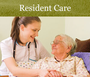 Resident Care Link. Resident Laughing With Staff Member