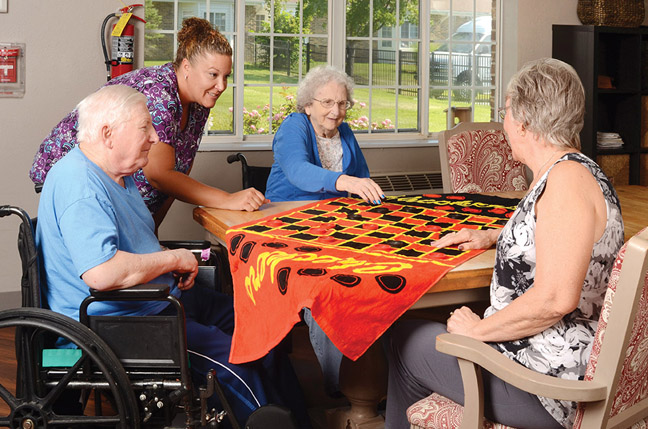 Residents Playing Game Of Checkers