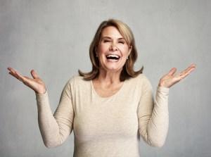 mature woman happy with her hands up