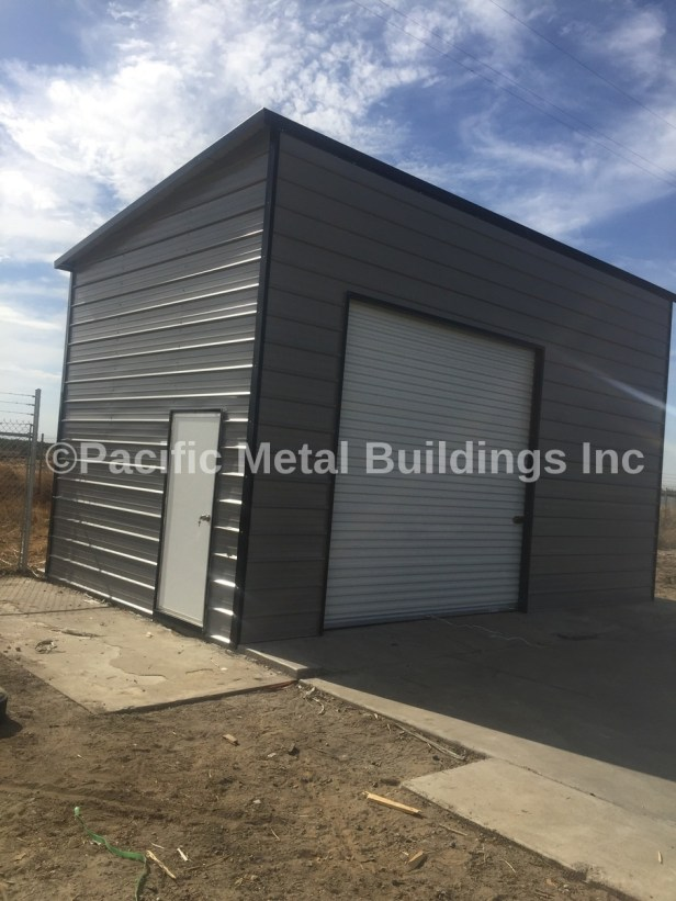 #6239 Box Eave Lean Too fully enclosed with a roll up door on one side and a man door on one end