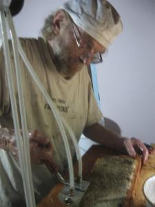 Ian Using the Honey Paw Uncapper