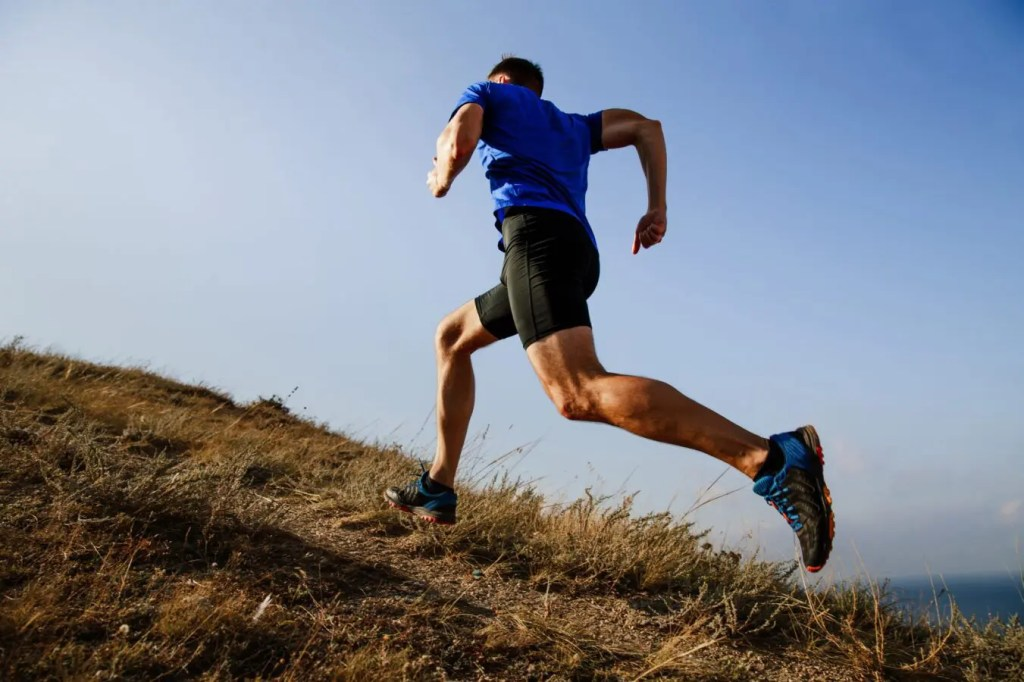 man running up hill after getting integrative health services