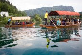The Pletna boat is a wooden flat-bottom boat propelled by two oars and operated by the Pletna oarsman, a very respectable profession.