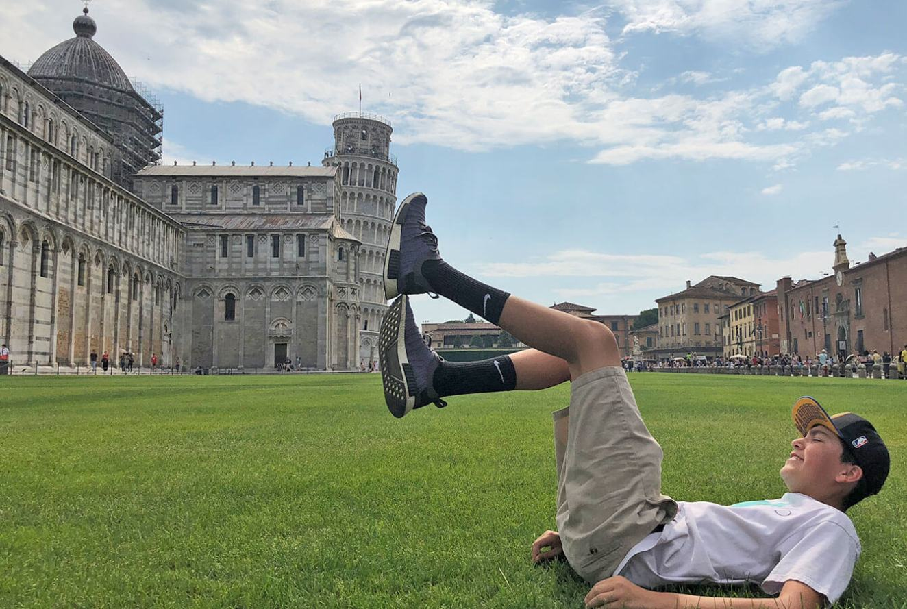 My nephew doing his best to hold the Tower of Pisa with his feet!