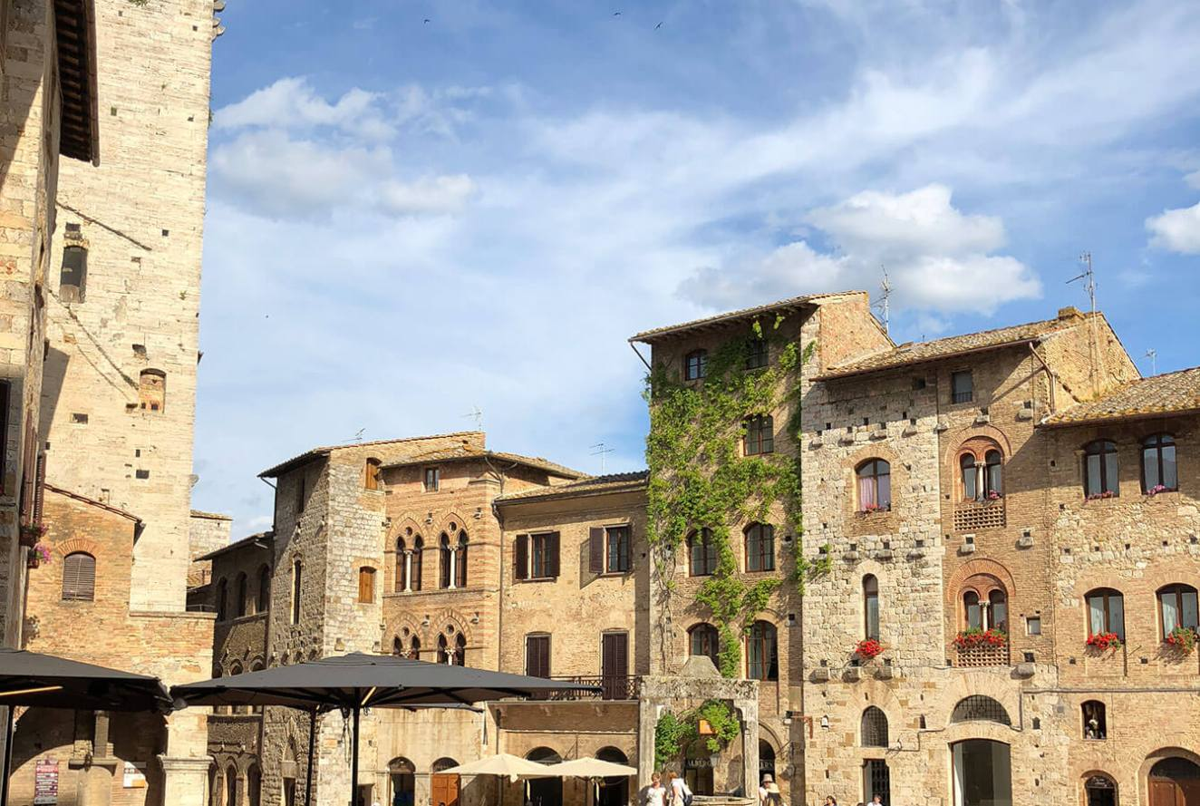 San Gimignano - Beautiful houses decorated with flowers.