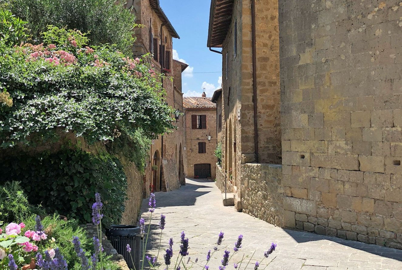 Alley with flowers in Monticchiello Tuscan Village
