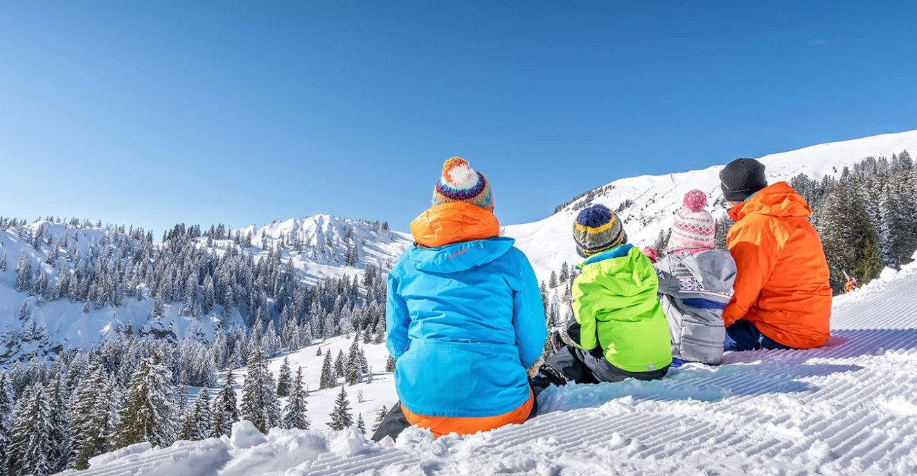 a family in the perfect winter resort Villars-Gryon, Switzerland