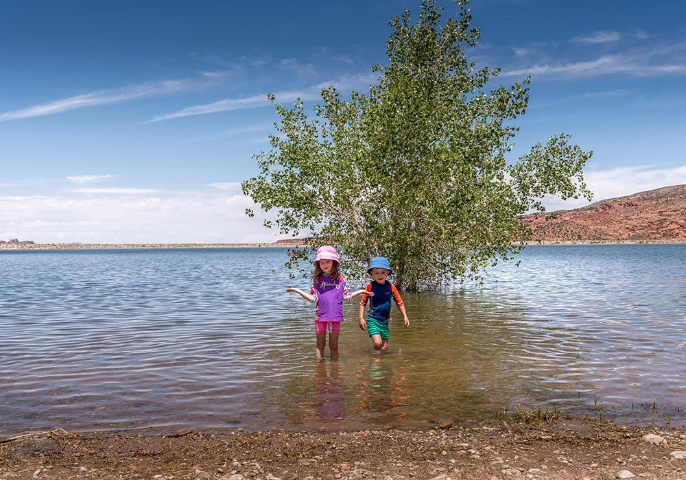 kids in the water at Kens Lake in Moab