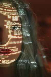 woman with text projected on her face