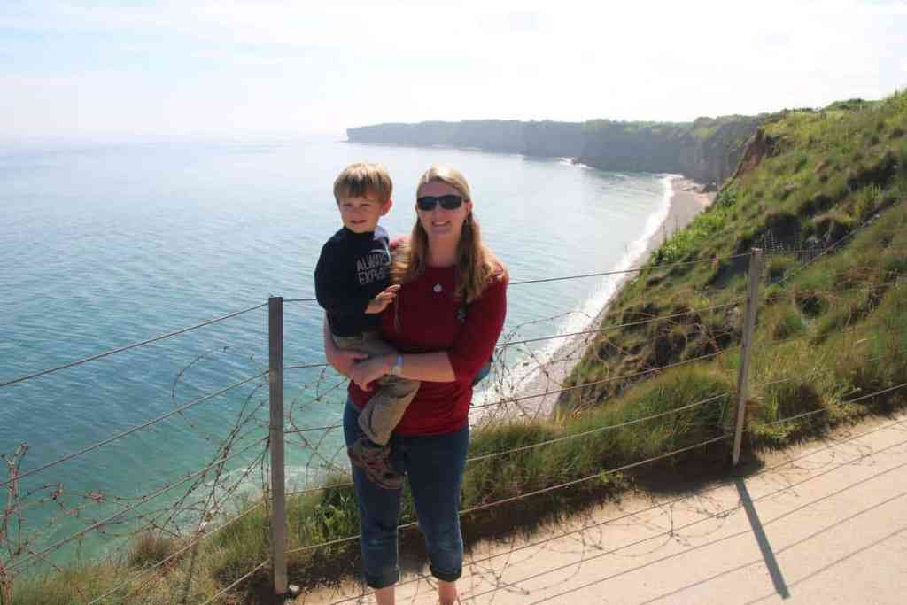 Mother and son standing on the cliffs of Pont Du Hoc