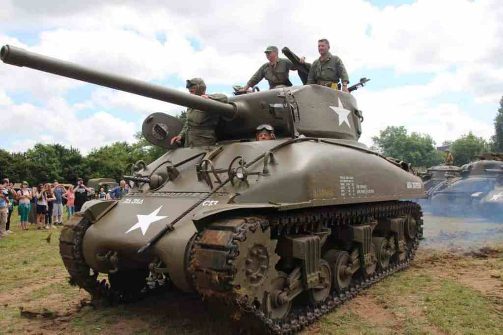 WWII tank driving out of the reenactment camps in St. Mere Eglise
