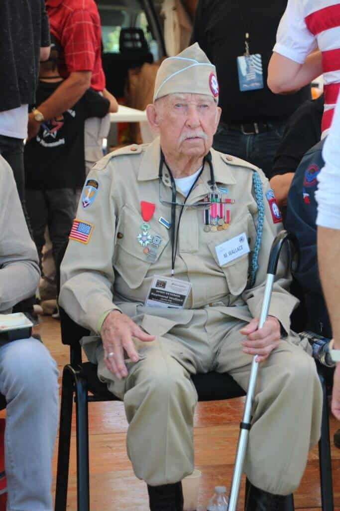 Wallace was a paratrooper in the U.S. Army's 82nd Airborne Division, and was among those who parachuted into Normandy, France, on June 6, 1944 - D-Day.