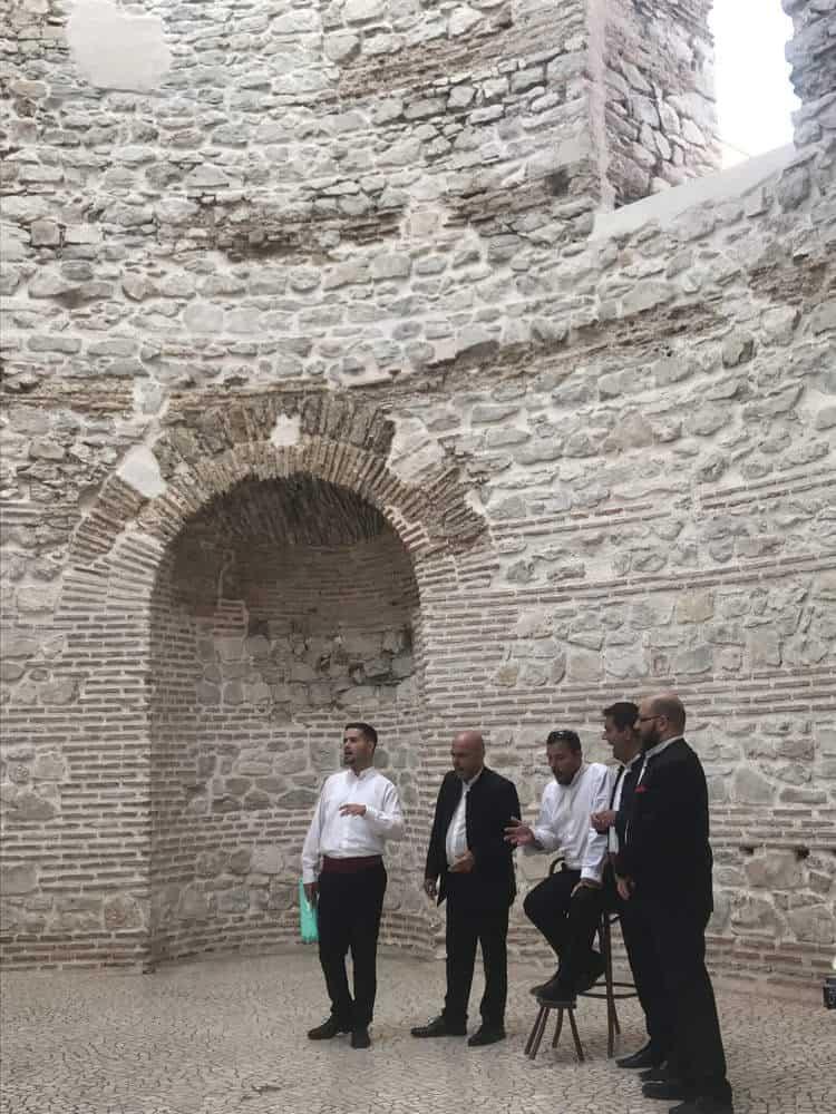 Cappella singers performing klapa in the Diocletian's vestibule in Split, Croatia