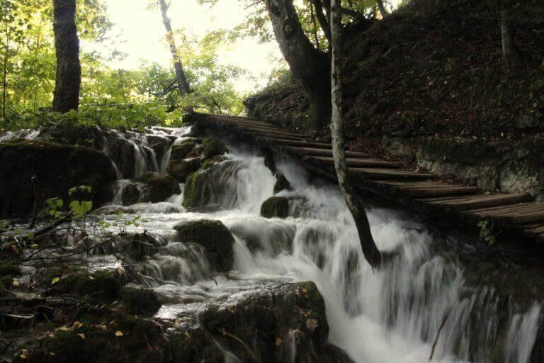 Waterfalls flowing below wood walkways in Plitvice National Park, Croatia
