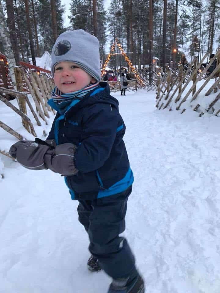 Boy dressed in full winter gear