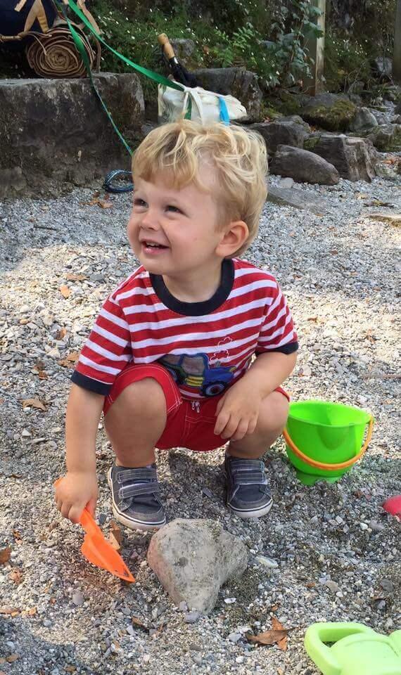 Playing on the beach near Lake Como, Italy