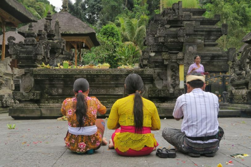 People praying at temple