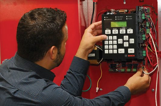 Technicial Installing a Panel