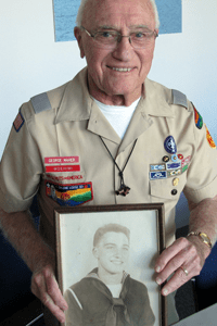 George Maher holds Navy photo