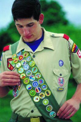 Eagle Scout wearing merit badge sash
