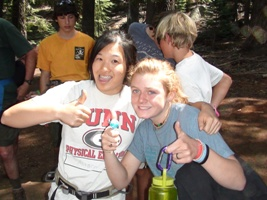 Camp staff fun gals with thumbs up
