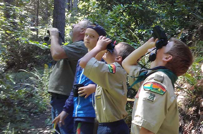 3 Scouts and docent on nature trail