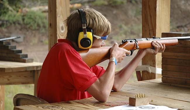 Scout shooting rifle at Oljato's new range