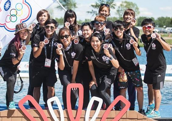 Dragon boat team at Worlds showing their medals