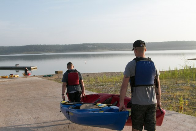 carrying a kayak by hand