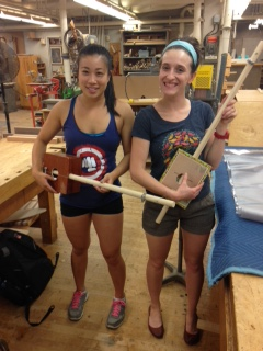 Cheryl and Music Library Supervisor, Memory Apata, MALS with their completed diddley bows