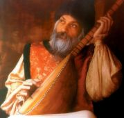 Osho_with_instrument