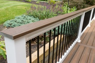 White vinyl railing with black aluminum balusters.