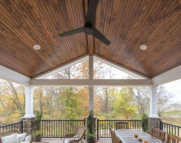 Ceiling fan over deck seating area.