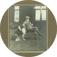 Andrew Carnegie seated next to dog