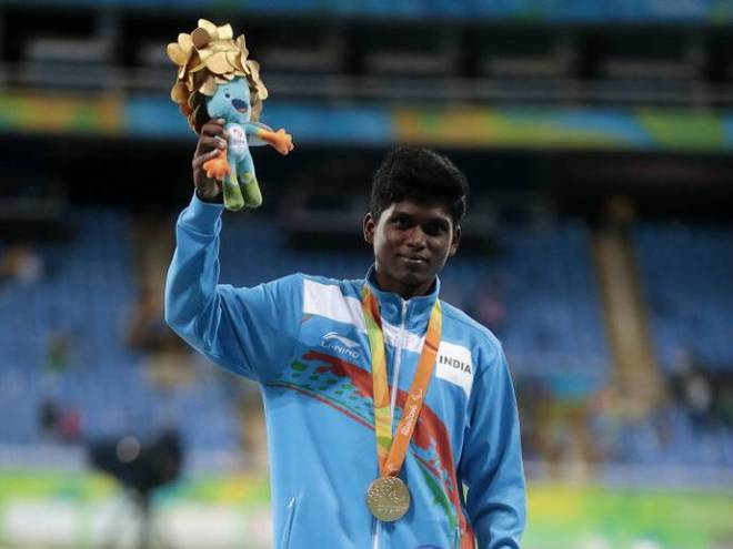 Mariyappan posing with his Rio2016 gold medal and the mascot toy