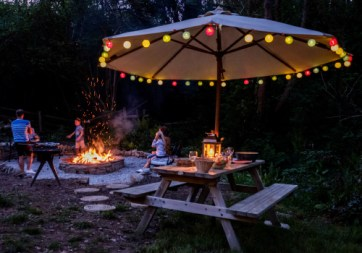 Padstow-creek-holiday-accommodation-cornwall-luxury-glamping-firepit-at-night-3