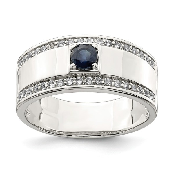 Men's sterling silver ring, prong set with a round, blue sapphire that weighs 2.15 ct. The ring is accented on each side, by thirty-six, round, prong set white topaz. This ring, also, has a polished finish and a closed back.