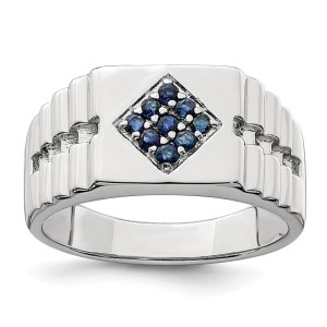 Men's sterling silver ring with nine, prong set, round sapphires that all together weigh .36 pts. The ring is accented by textured sides and a polished finish.